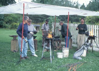 David Demonstrating                                       Blacksmithing at Joseph Schneider                                       Haus picture.