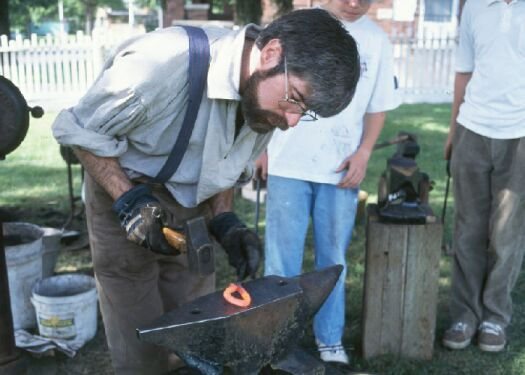 David demonstrating                                       blacksmithing image.