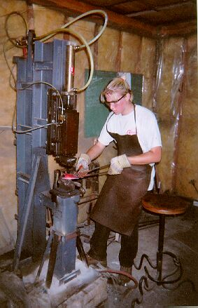 Blacksmith                                                       Student Using the                                                       air hammer
