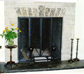 Ontario blacksmith                               custom made fireplace screen.