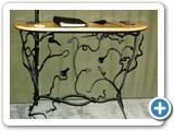 Decorative ironwork consul table